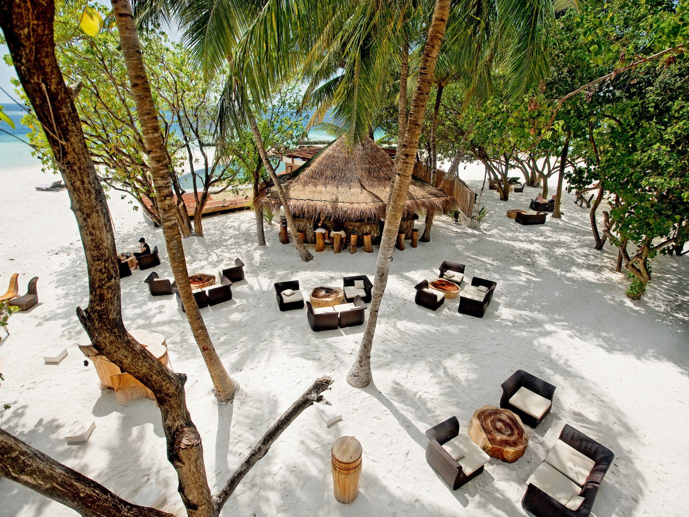 All-Inclusive Resorts Beach Beachfront Dining Grounds Hotels Island Lounge Luxury Luxury Travel Romance Romantic tree outdoor season Resort plant