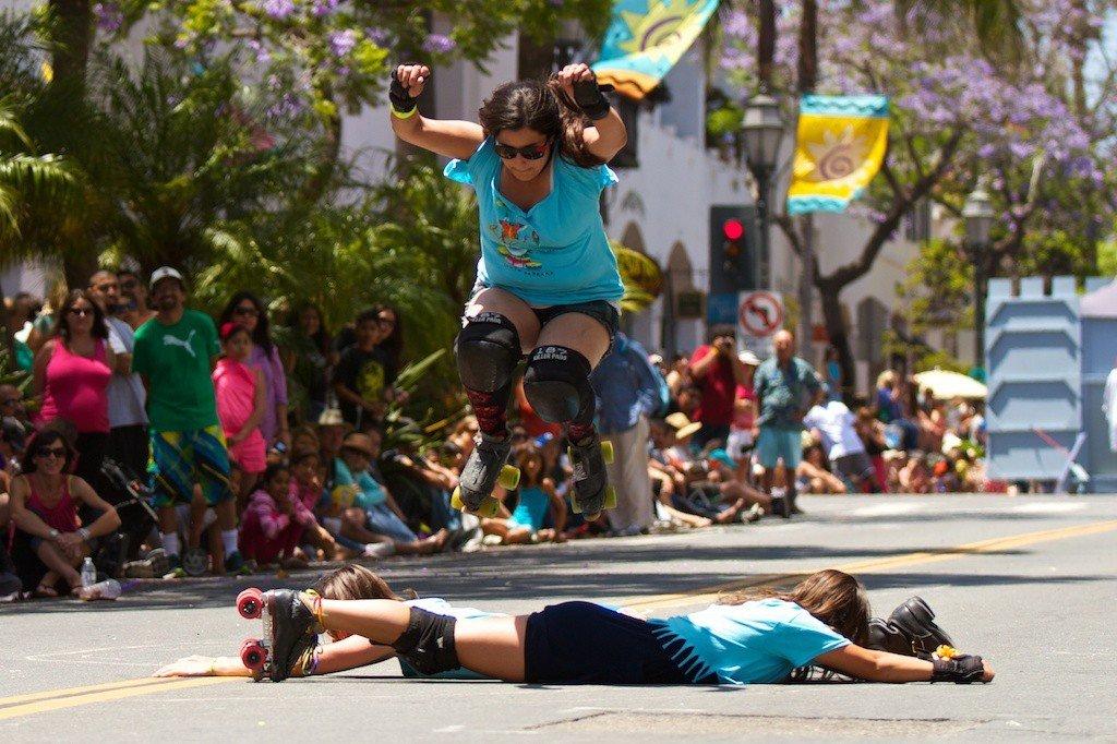 Festivals + Events Offbeat Trip Ideas Yoga Retreats person tree outdoor road Sport festival event parade pride parade