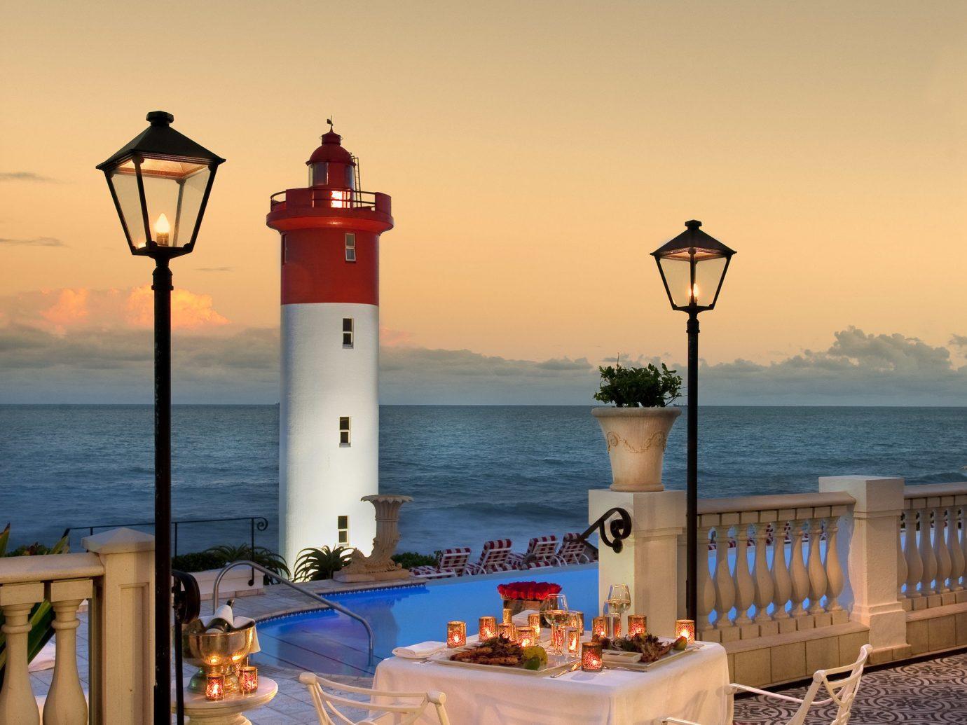 Hotels water sky Beach Sea vacation Ocean Sunset morning evening Coast dusk