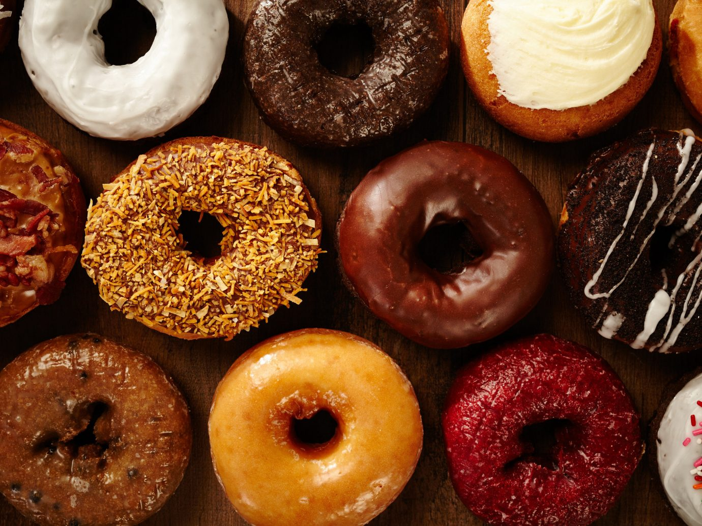 Boutique Hotels Fall Travel Trip Ideas Weekend Getaways doughnut donut rack cider doughnut dessert glaze food baking sweetness grill plain baked goods different finger food flavor pastry lined assorted bagel half variety colorful several pan colored