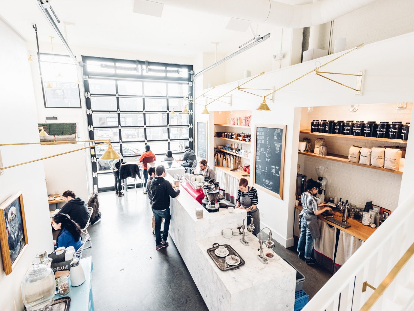 airy barista café chic clean coffee coffee shop Health + Wellness Hip interior natural light people tables Travel Tips trendy urban white window windows indoor wall room Design interior design cluttered