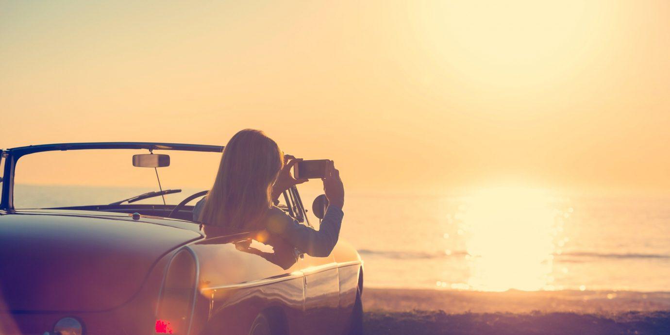 Travel Tips sky outdoor Sunset car vehicle light morning sunrise Sun atmosphere of earth evening reflection sunlight dawn dusk