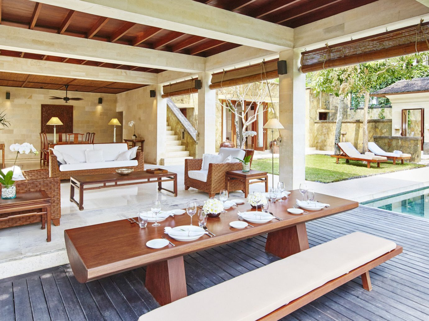 Health + Wellness Hotels table floor indoor property chair building room Living estate Resort wooden Villa home interior design living room cottage real estate outdoor structure furniture porch wood farmhouse dining room Deck
