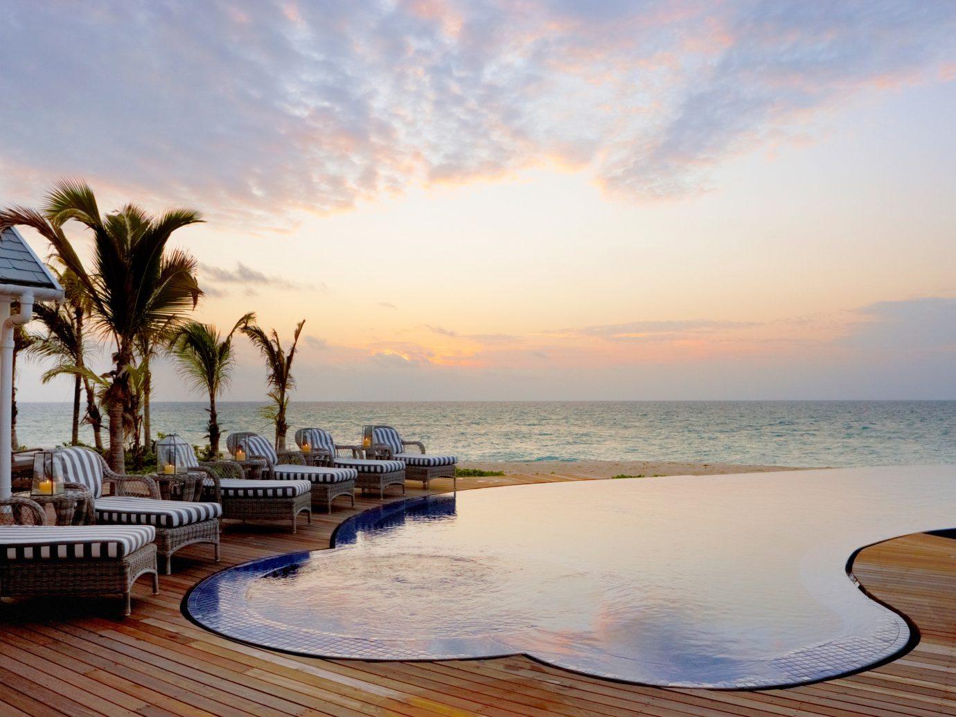Honeymoon Hotels Luxury Travel Romance Trip Ideas outdoor water sky Sea shore Ocean vacation horizon Beach Sunset Coast morning evening bay dusk caribbean Resort sunrise