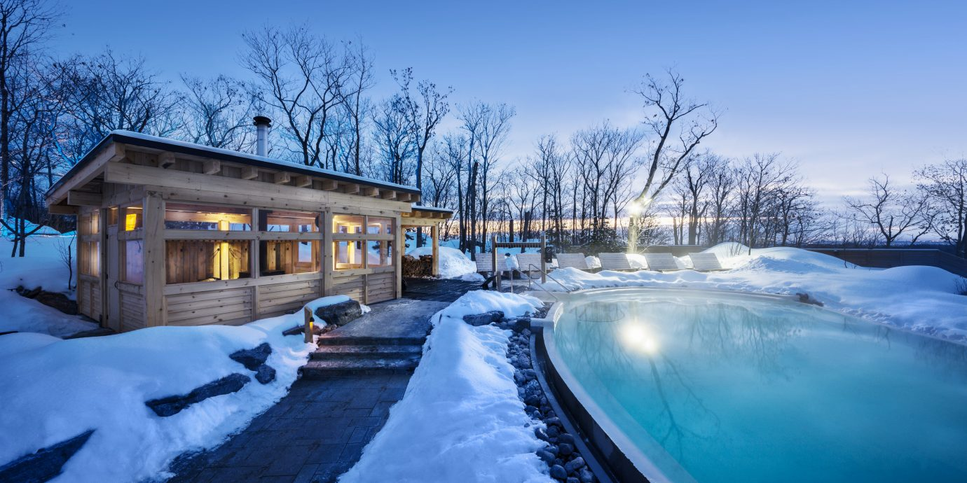 Health + Wellness Hotels Spa Retreats Trip Ideas snow outdoor sky tree Winter weather season covered freezing Nature morning landscape ice reflection