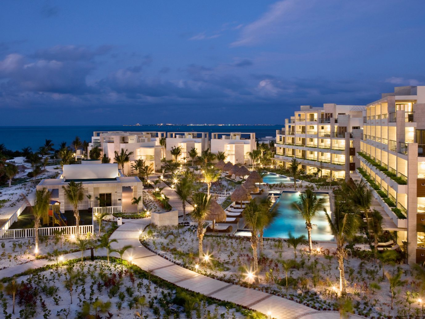 Grounds Hotels Luxury Modern Tropical outdoor sky building Town cityscape City neighbourhood Resort residential area vacation tourism Downtown estate marina Coast Sea skyline aerial photography Harbor