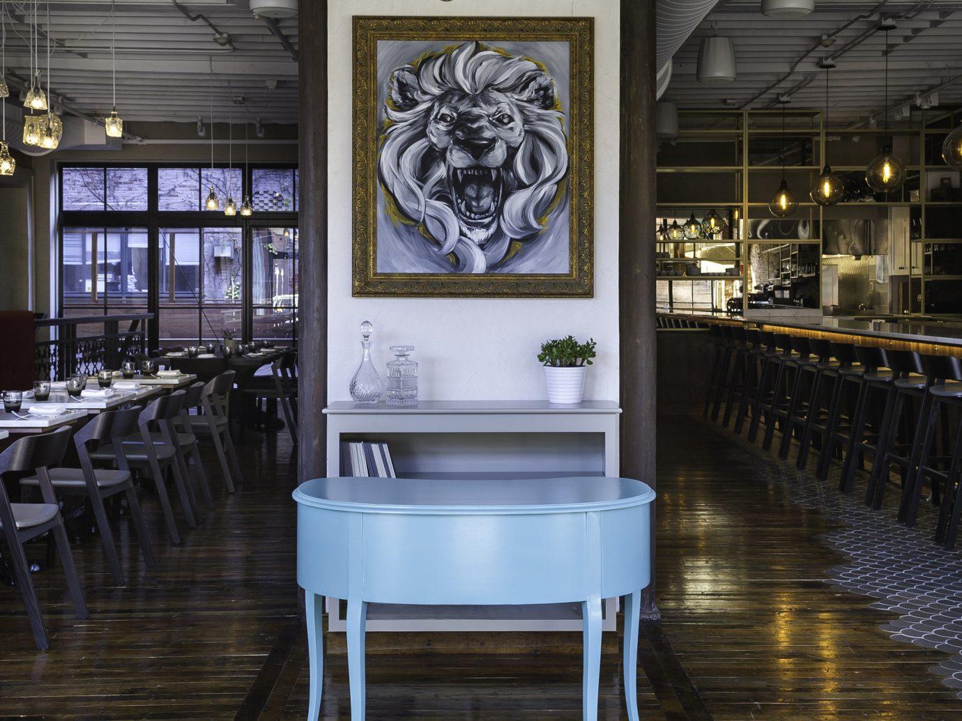 Food + Drink floor indoor furniture interior design Lobby flooring table chair area