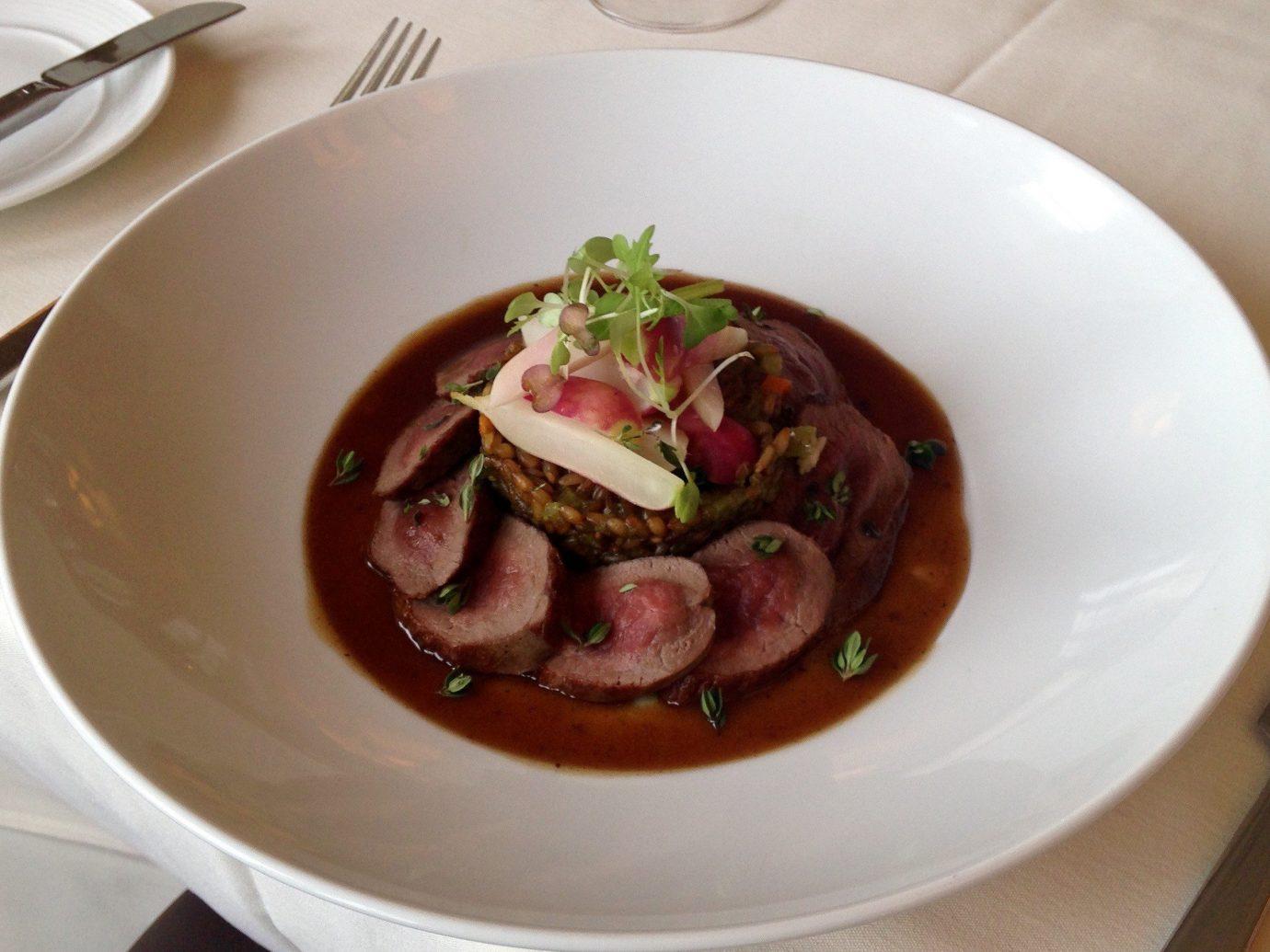 Food + Drink plate table food dish indoor meat meal cuisine produce restaurant vegetable soup piece de resistance