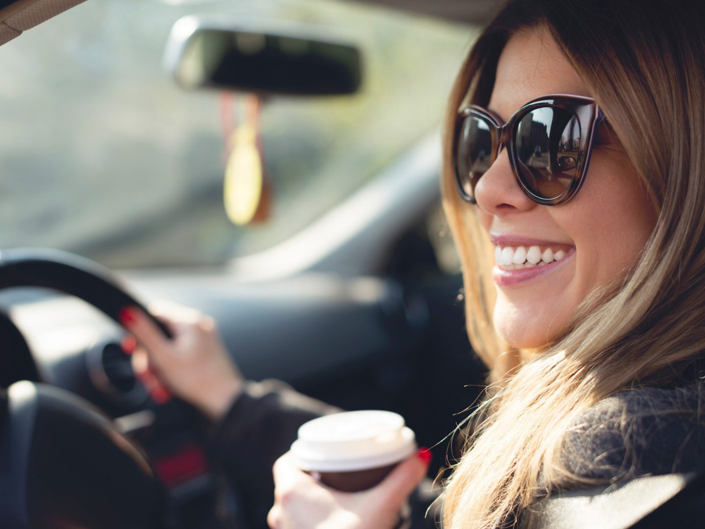 Road Trips Travel Tips person outdoor car woman eyewear glasses vision care sunglasses girl smile driving automobile make model vehicle spectacles lady close goggles