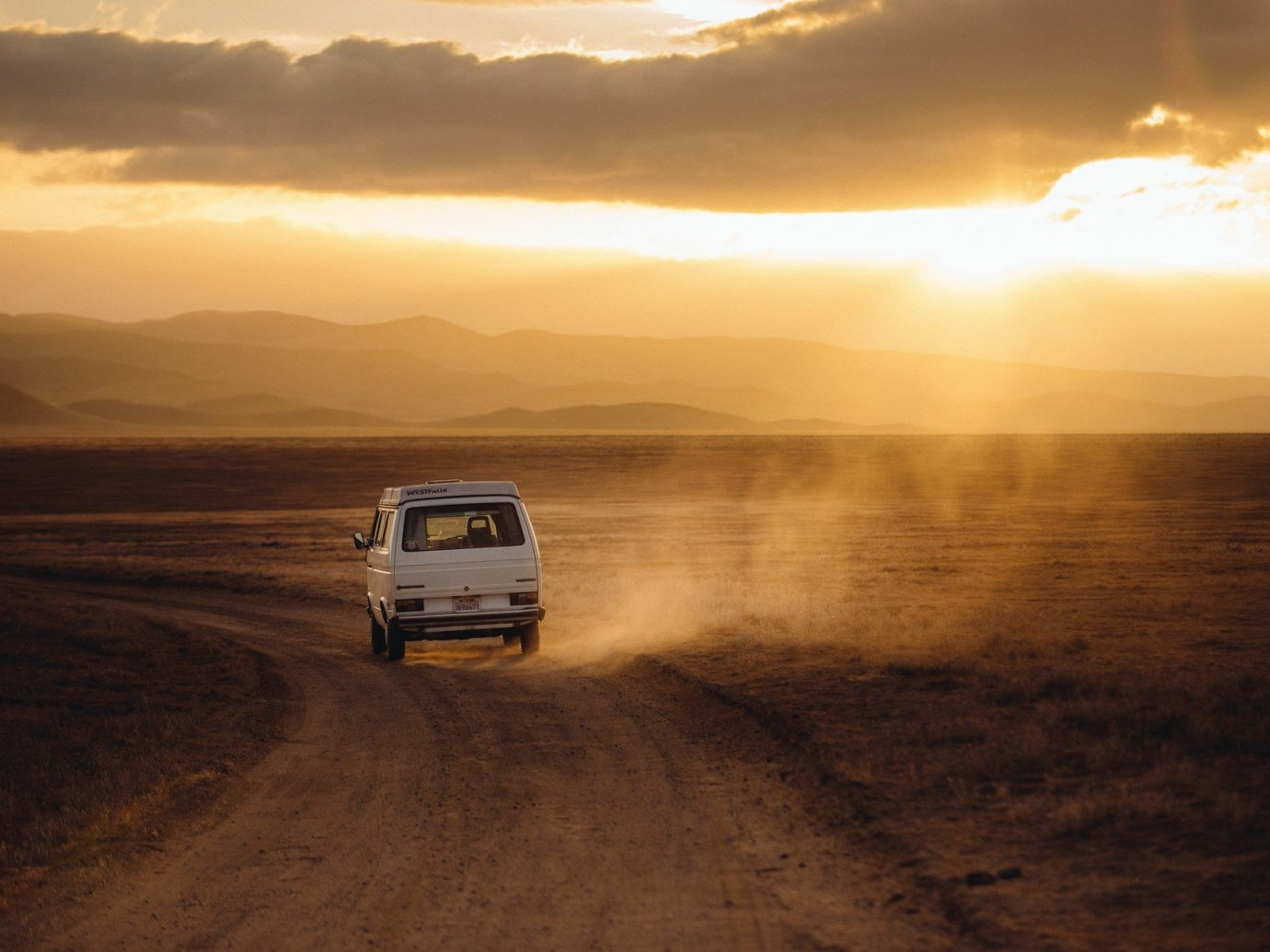 calm car flare glare glow golden hour isolation majestic Mountains orange orange sky remote road roadtrip serene Sunset Travel Tips outdoor sky atmospheric phenomenon horizon natural environment sunrise Beach morning dawn cloud evening landscape dusk Sea sunlight Desert Coast sandy