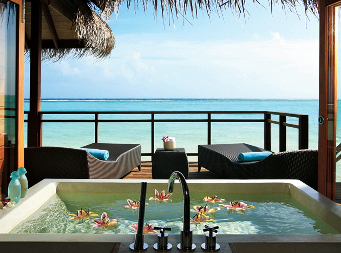 Outdoor bathtub at LUX* South Ari Atoll