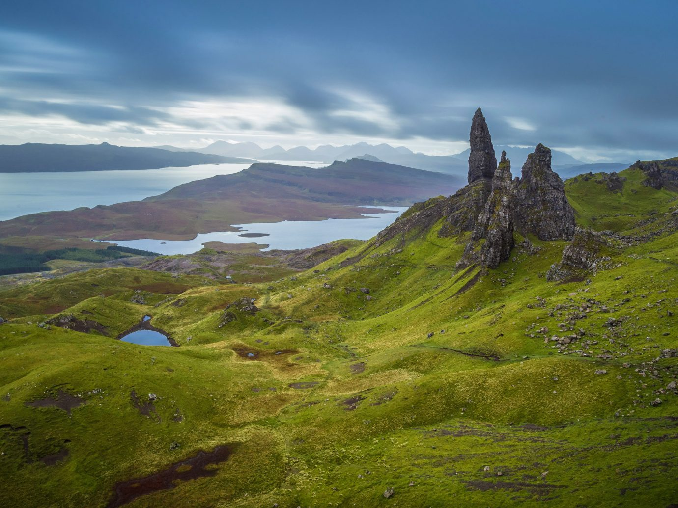 Travel Tips sky grass outdoor mountain highland mountainous landforms Nature hill geographical feature landform mountain range wilderness green hillside loch fell cloud Lake alps landscape plateau ridge mountain pass meadow terrain fjord grassy lush valley cliff reflection overlooking land