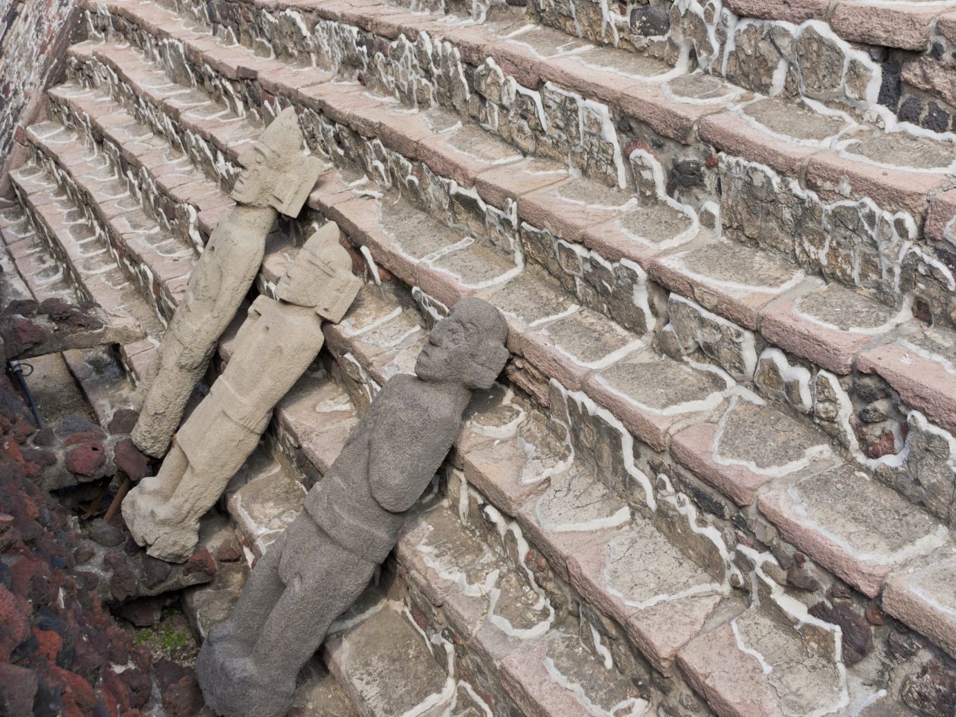 Arts + Culture Mexico City Travel Tips Trip Ideas stone carving ancient history archaeological site wall Ruins carving stone wall history historic site rock geology relief