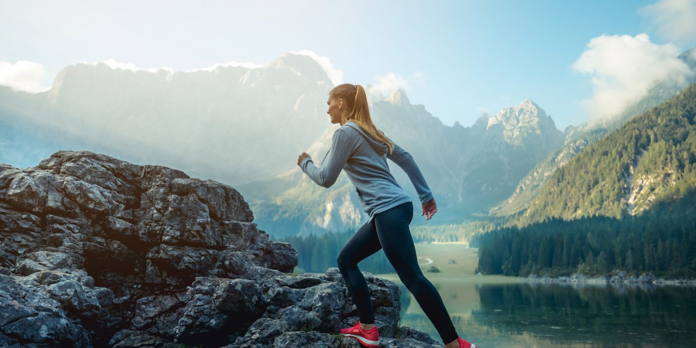 Health + Wellness Style + Design Travel Shop mountainous landforms Nature water mountain sky mountain range rock girl photography outdoor recreation fun Adventure tree glacial landform terrain vacation cloud tourism fell alps ridge fjord landscape recreation hill cliff Lake hiking