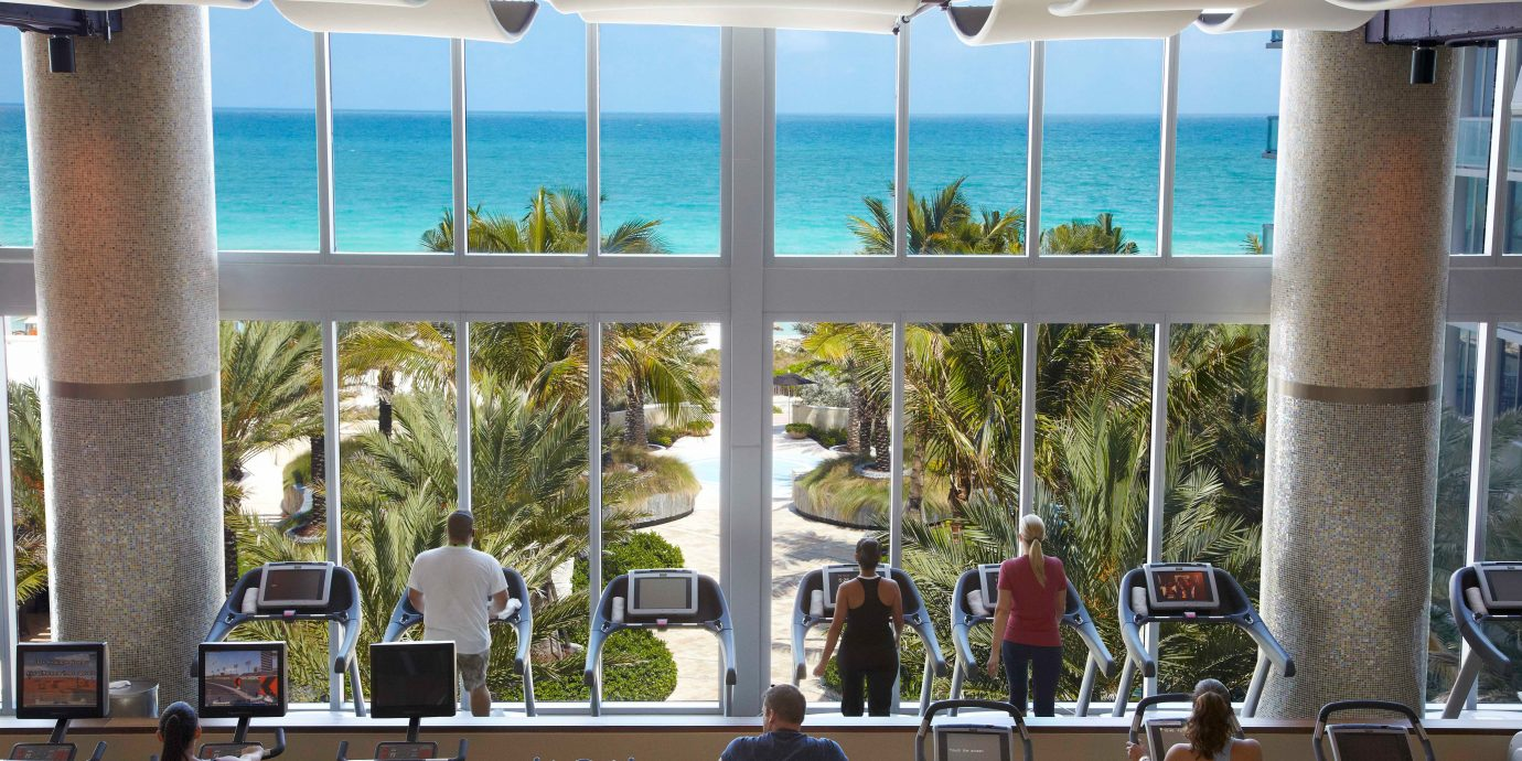 Beachfront Fitness Health + Wellness Hotels Scenic views Sport Wellness Yoga Retreats chair room home estate interior design vacation Resort restaurant window window covering several day Island