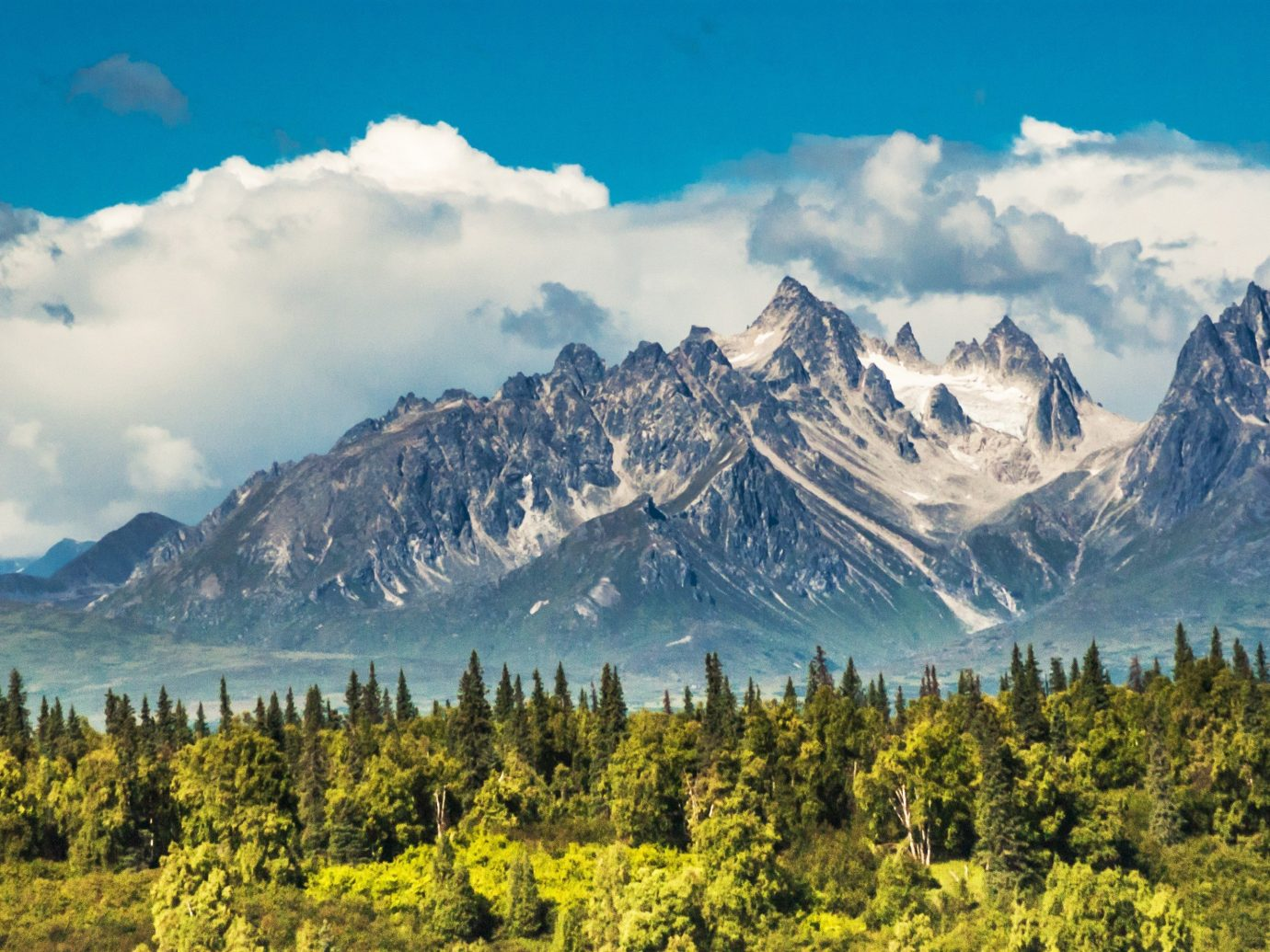 Mountains + Skiing Trip Ideas mountain sky outdoor mountainous landforms tree mountain range Nature geographical feature landform wilderness ecosystem ridge cloud valley alps background landscape plateau meadow national park mountain pass plant hillside lush highland