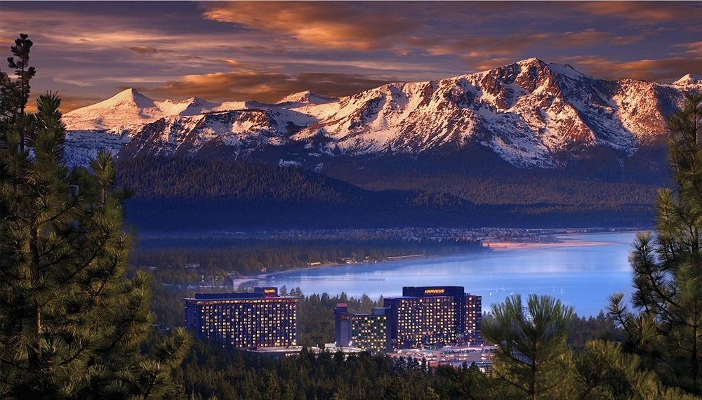 Casino Classic Lake Mountains Mountains + Skiing Resort Scenic views Ski Trip Ideas tree outdoor sky mountain mountainous landforms Nature wilderness atmospheric phenomenon reflection mountain range night morning background cloud evening landscape loch dusk dawn sunrise panorama Sunset Forest overlooking hillside surrounded