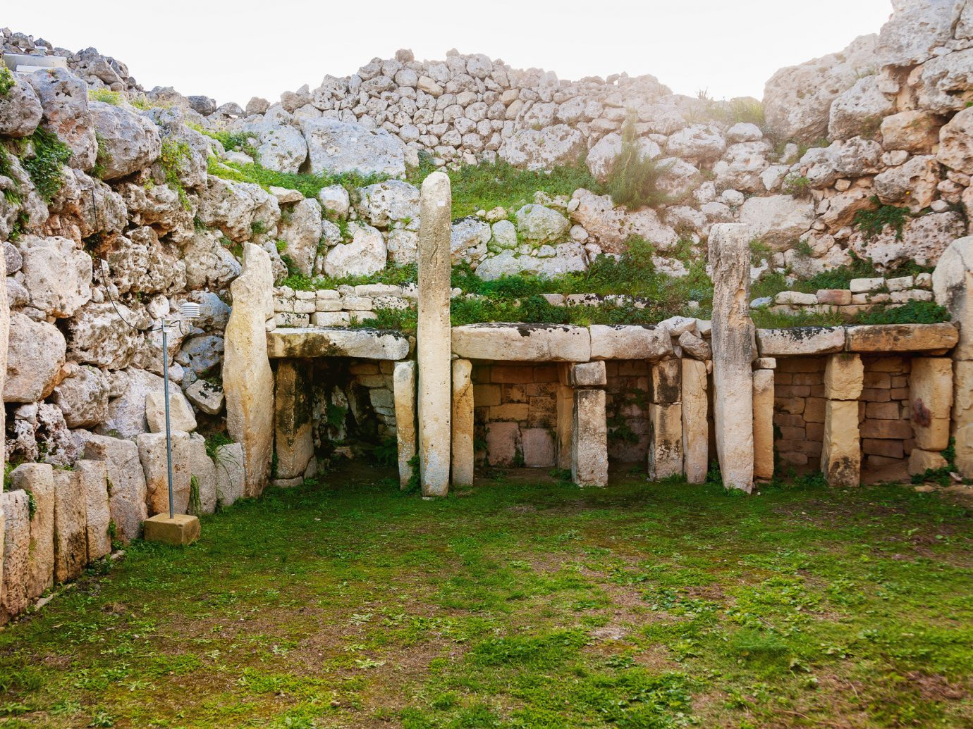 Trip Ideas grass rock outdoor wall Ruins building ancient history stone Village monastery flower temple arch formation place of worship shrine megalith lush