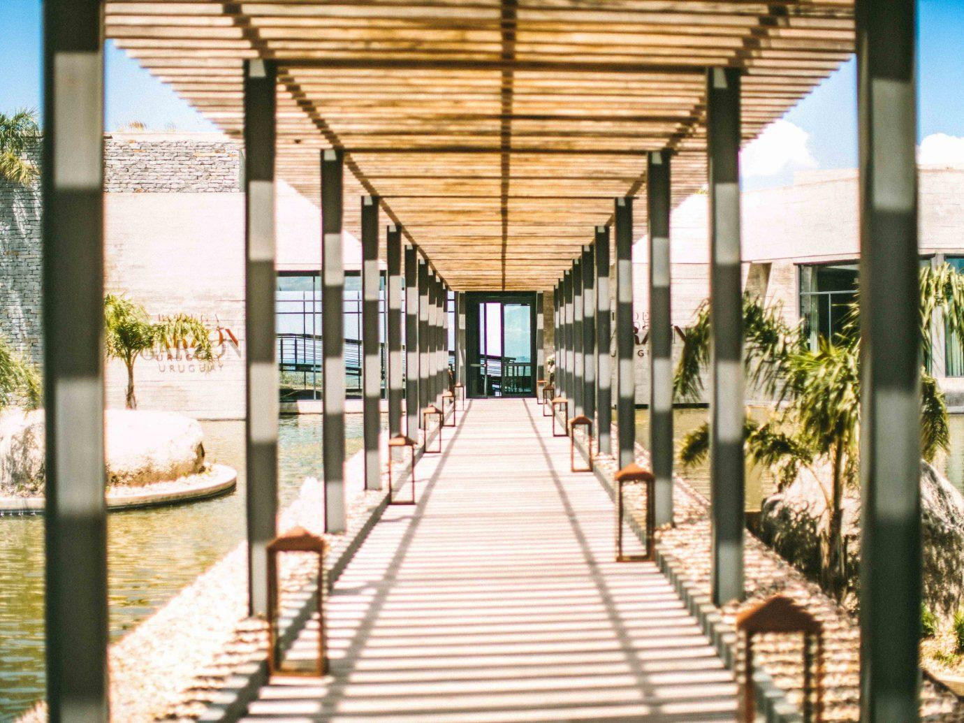 Beach Romantic Getaways south america Trip Ideas Uruguay real estate walkway condominium outdoor structure building house facade apartment window
