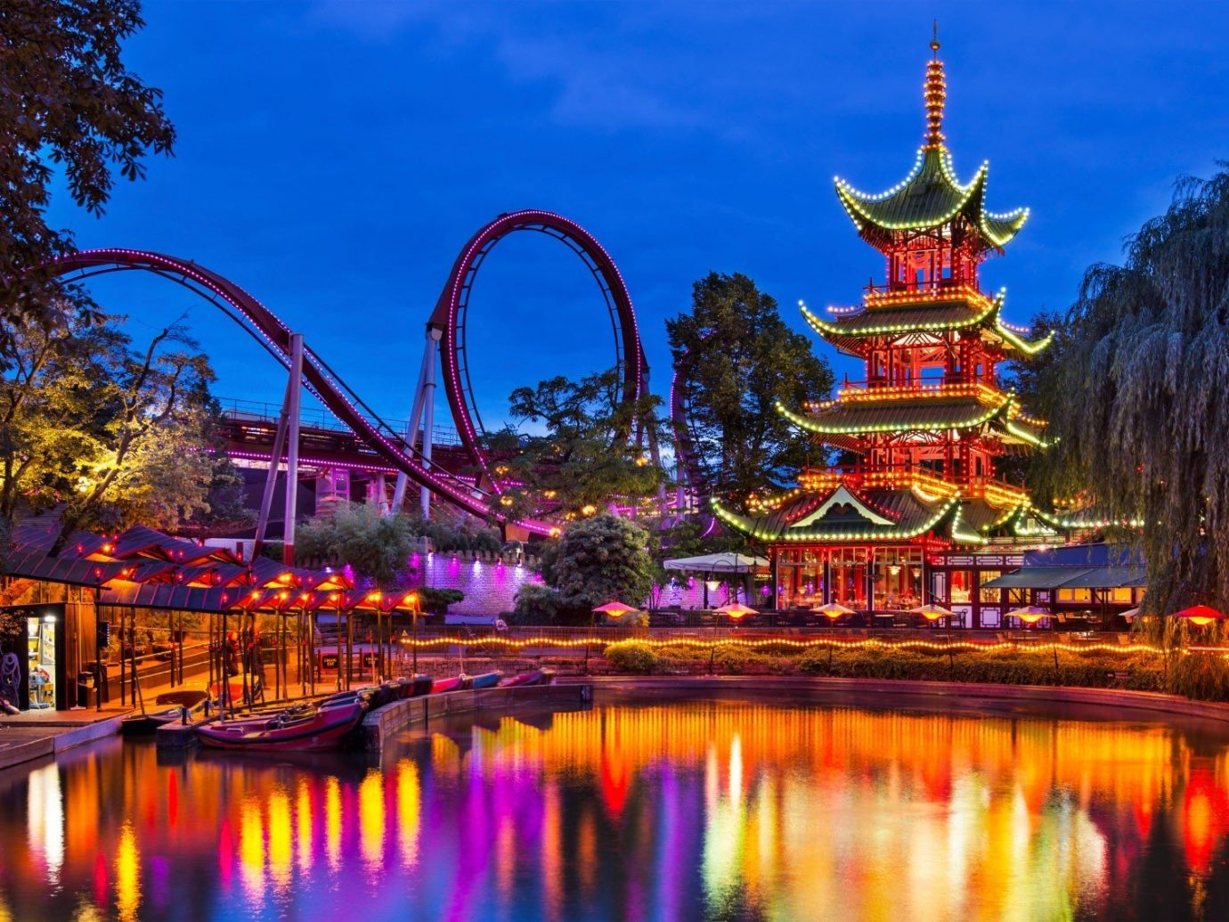 Offbeat tree water outdoor sky landmark River amusement park night reflection park evening cityscape Resort temple colorful