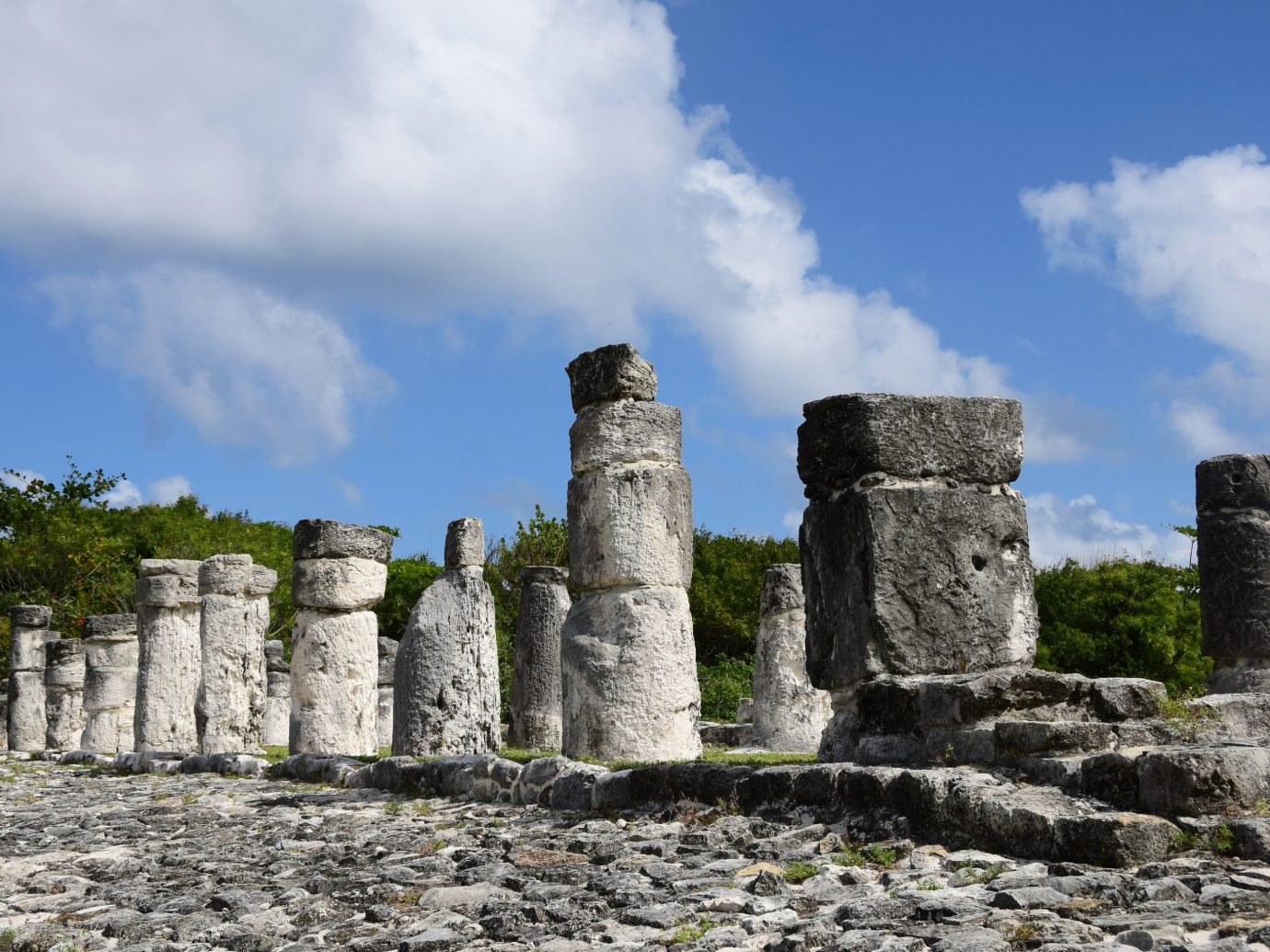 Travel Tips building rock outdoor historic site Ruins ancient history archaeological site sky stone maya civilization cloud history maya city tourist attraction grass column unesco world heritage site tours castle