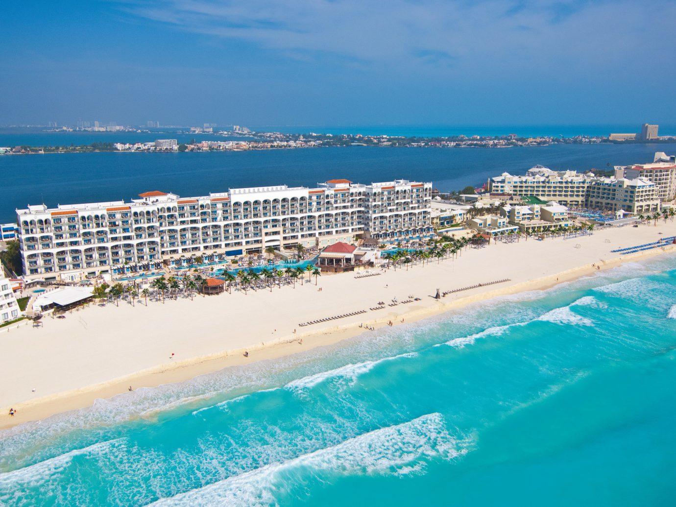 Hotels sky outdoor water Sea coastal and oceanic landforms Beach shore vacation Ocean Coast tourism Resort horizon caribbean swimming pool daytime Nature bay leisure