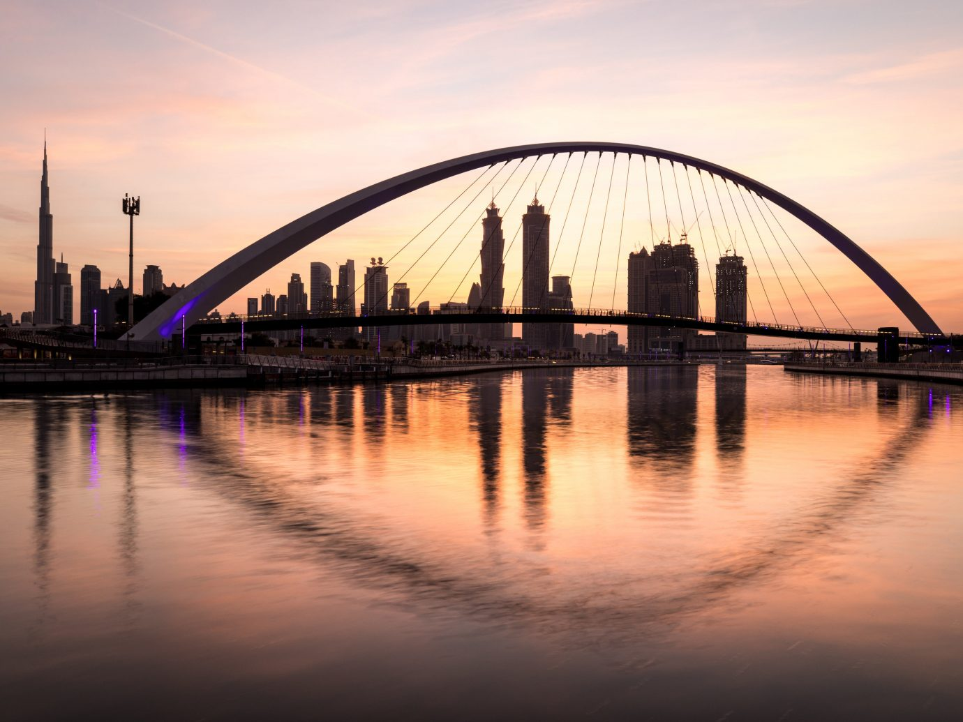Travel Tips sky water bridge River outdoor reflection Boat landmark building Lake Sunset horizon dusk dawn evening morning skyline sunrise cityscape long sunlight cable stayed bridge nonbuilding structure waterway traveling arch distance