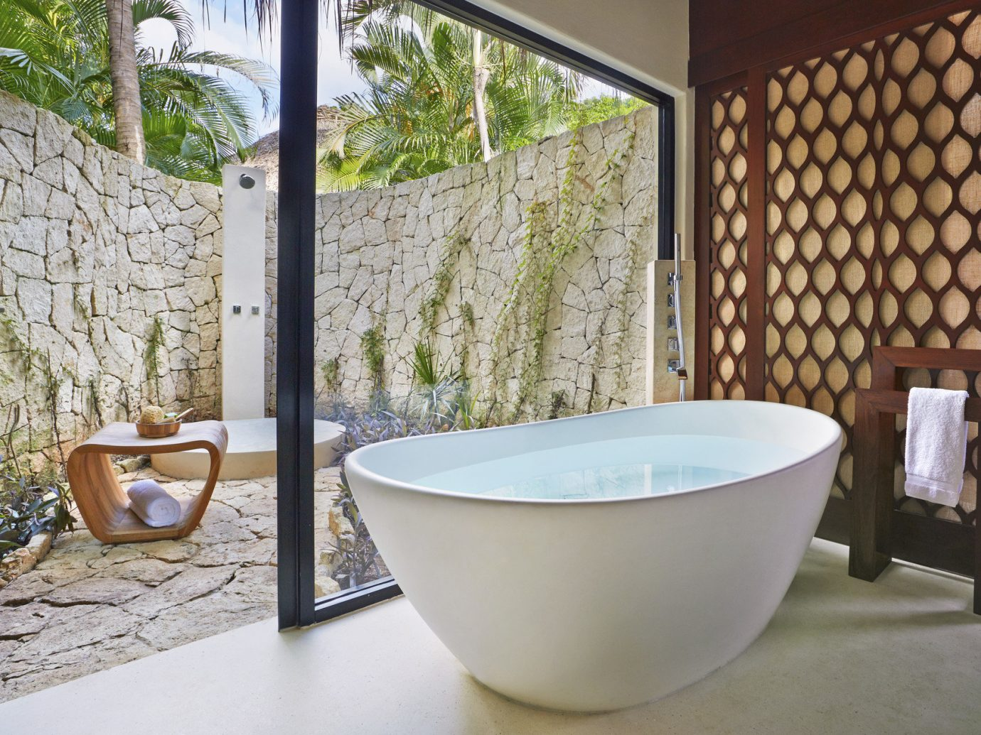 Beach Honeymoon Hotels Mexico Romance Tulum room property bathtub bathroom swimming pool plumbing fixture floor interior design bidet estate flooring jacuzzi stone
