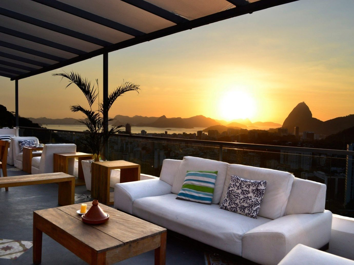Food + Drink table Living property room vacation estate Resort interior design Villa restaurant furniture area set