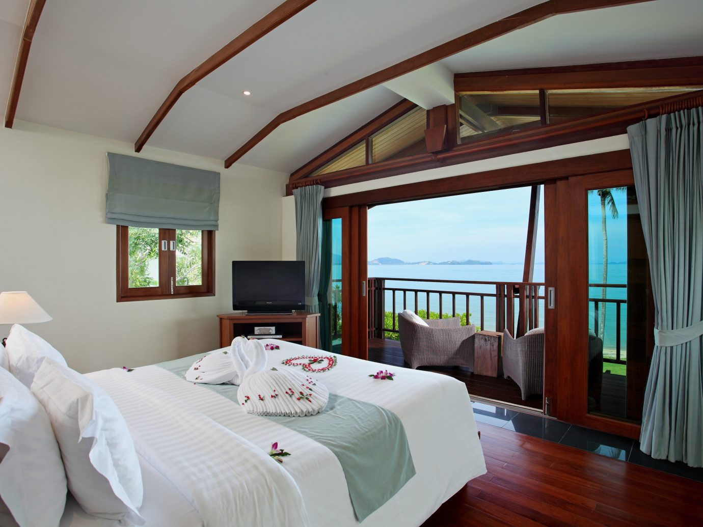 Beach Hotels Phuket Thailand indoor bed wall room floor Bedroom hotel ceiling Suite interior design pillow real estate estate window boarding house Resort wood furniture