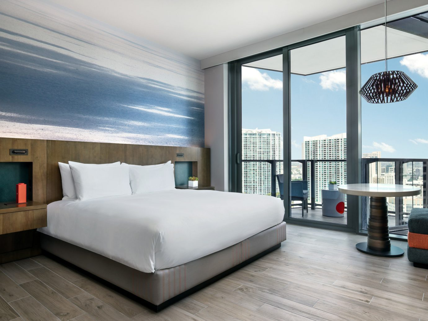 Balcony bed Bedroom Boutique chic city views clean contemporary Hip Hotels Luxury Modern Style + Design stylish trendy view windows floor indoor room property window furniture living room interior design condominium home real estate Design estate window covering apartment