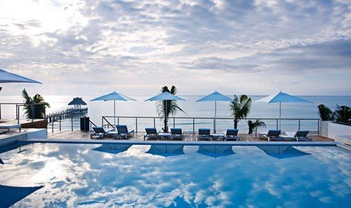 Hotels sky outdoor swimming pool property Resort blue vacation estate Villa cloudy clouds day
