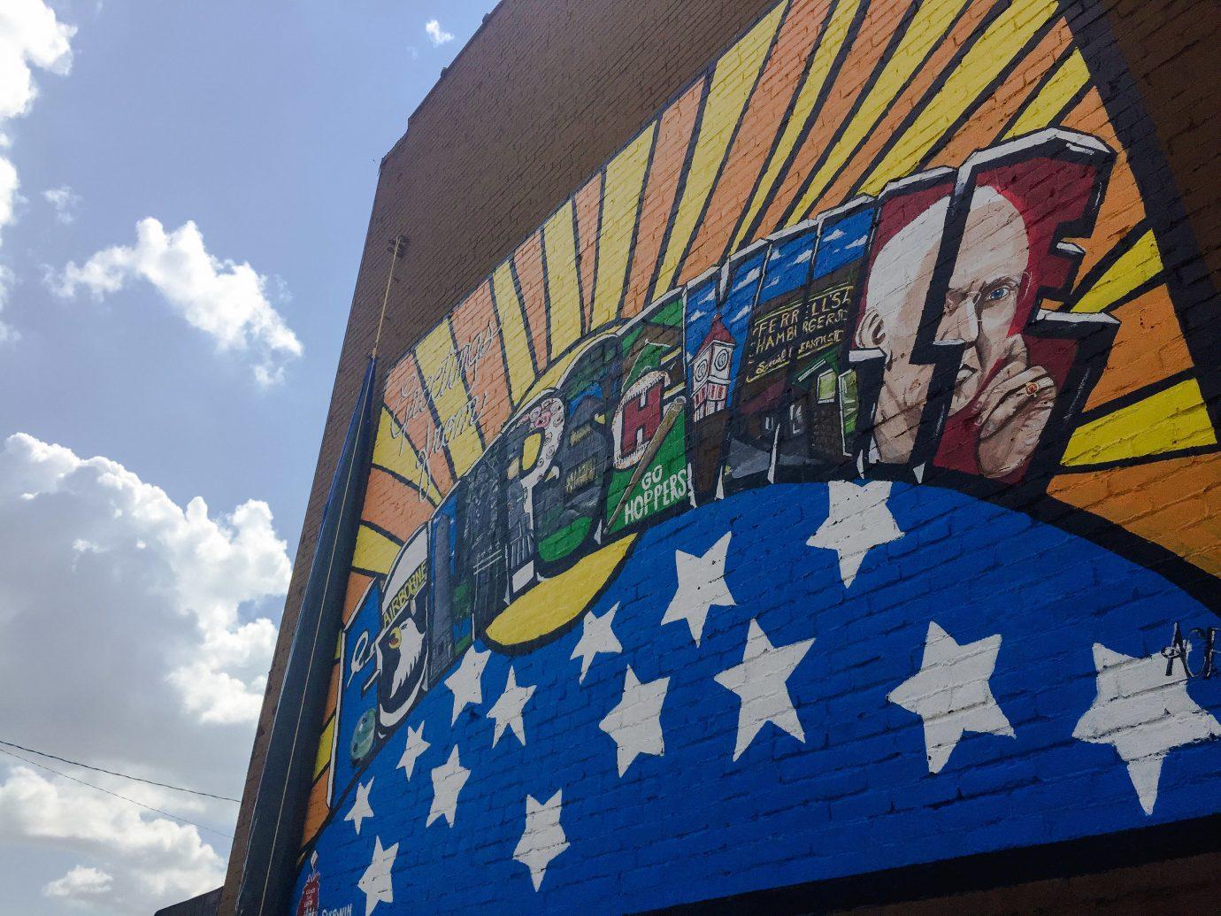Offbeat sky blue outdoor flag wall mural daytime street art graffiti painted