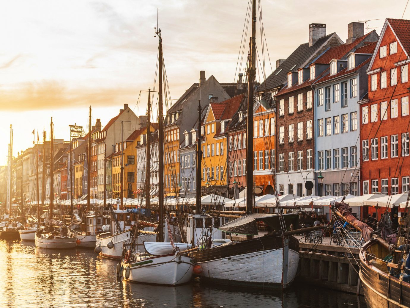 Offbeat Style + Design Travel Tips Trip Ideas sky outdoor Canal scene landform body of water Town waterway Harbor Boat cityscape vehicle River channel evening dock reflection several