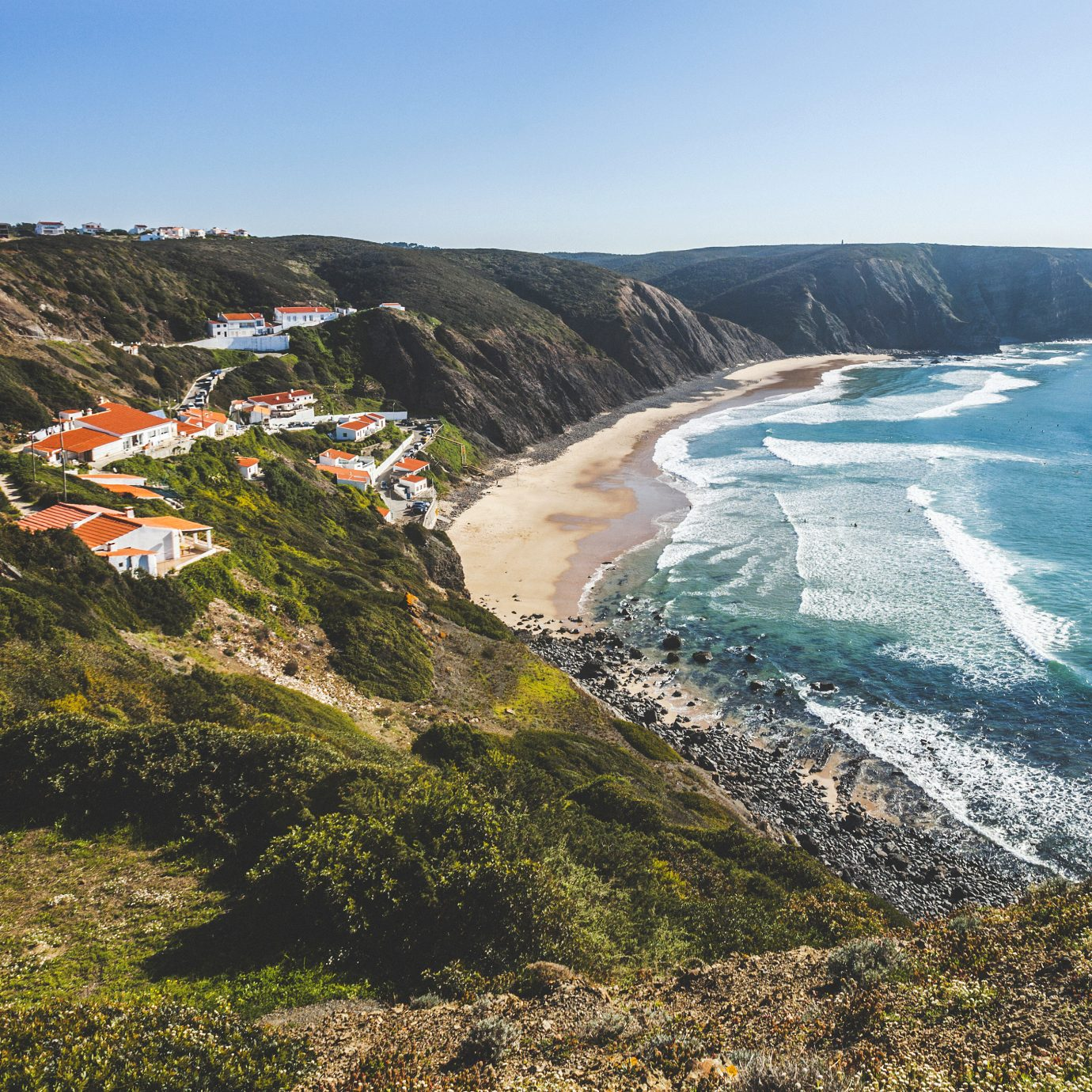 View from top of the hill to Arrifana beach, popular among surfers.
