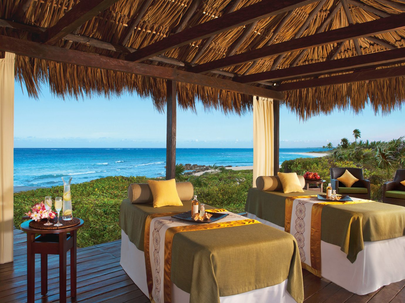 Beach Beachfront Hotels Romance Spa chair Resort property leisure ceiling vacation estate Villa restaurant caribbean hacienda cottage eco hotel hotel overlooking furniture several