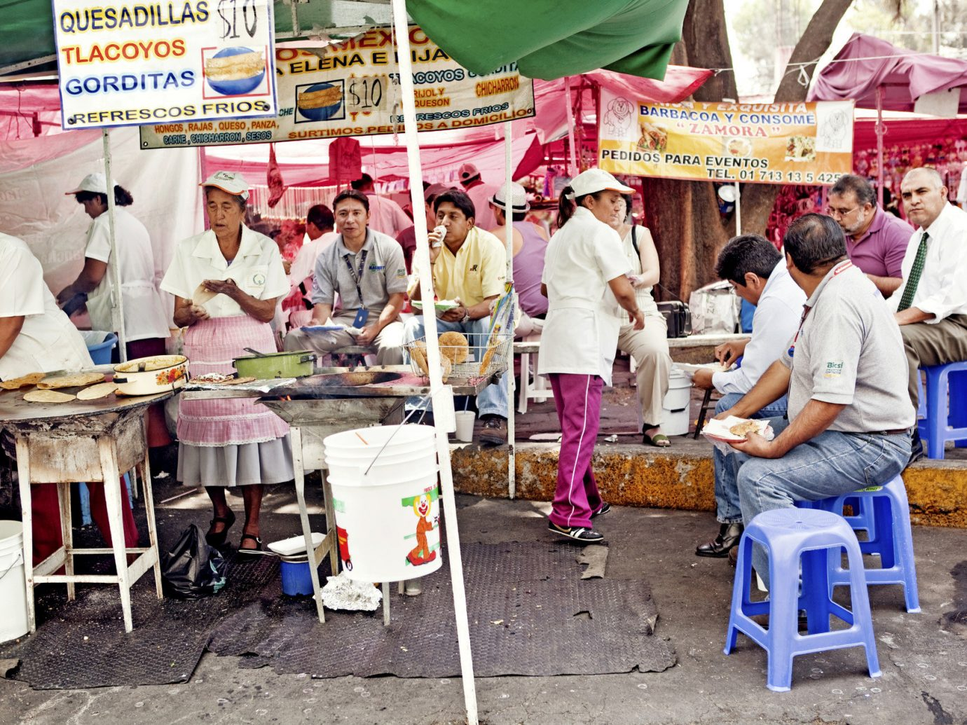 Offbeat Trip Ideas person City public space marketplace vendor market human settlement bazaar street food people group food cuisine stall fair