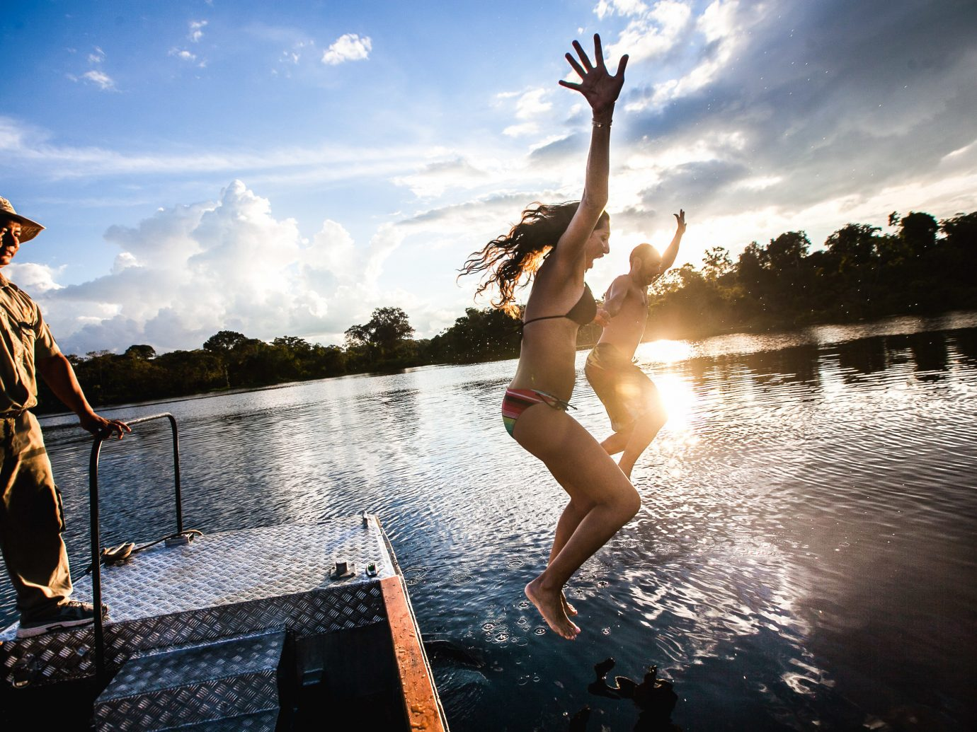 Cruise Travel Luxury Travel Outdoors + Adventure Travel Tips Trip Ideas sky outdoor water person reflection fun Boat leisure vacation girl photography Sea summer sunlight tree cloud jumping tourism recreation Lake happiness flash photography evening water feature day