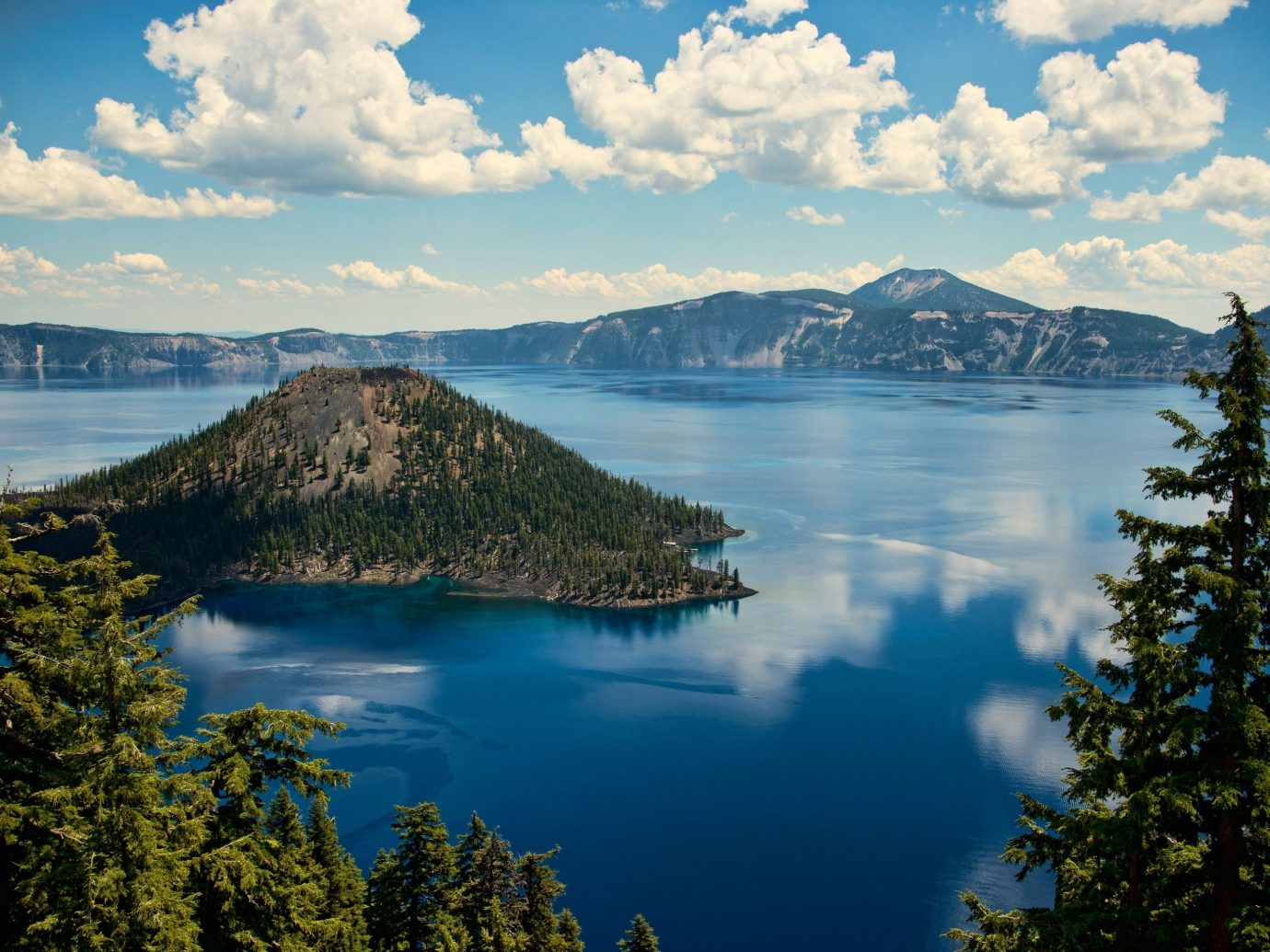 National Parks Outdoors + Adventure Trip Ideas water tree sky outdoor highland Nature Lake mountainous landforms reflection mountain body of water wilderness loch cloud reservoir tarn clouds crater lake fell landscape mountain range fjord Sea surrounded cloudy beautiful shore overlooking Forest hillside day