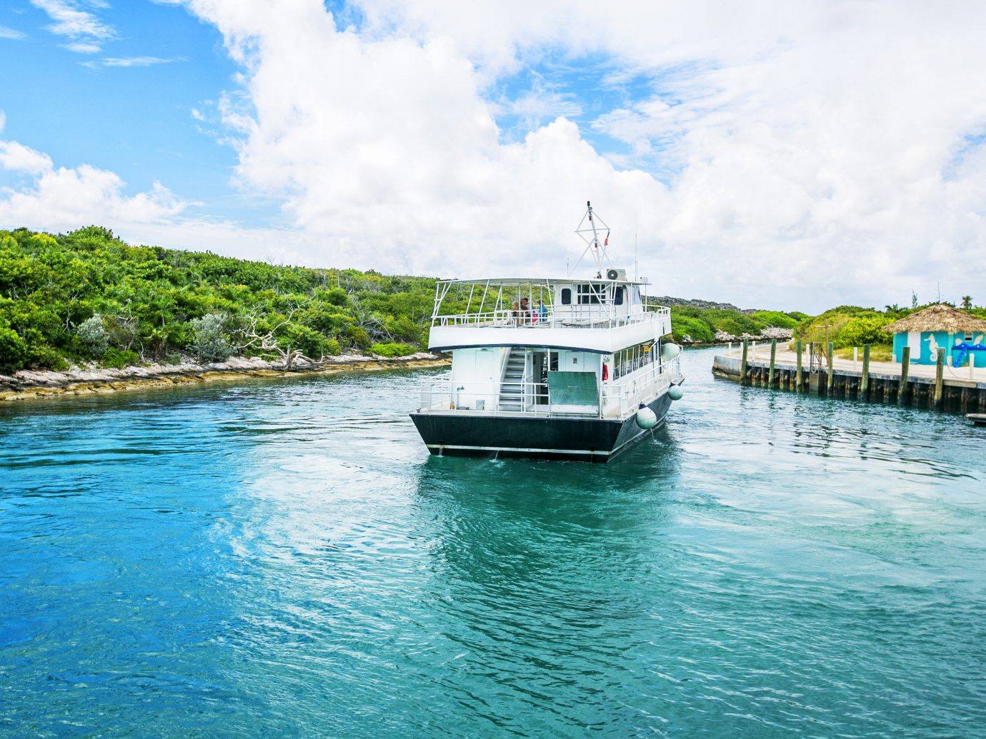 Beach Trip Ideas water sky outdoor Boat landform Sea geographical feature vehicle vacation Ocean shore ferry bay channel Coast caribbean passenger ship waterway Island ship traveling day