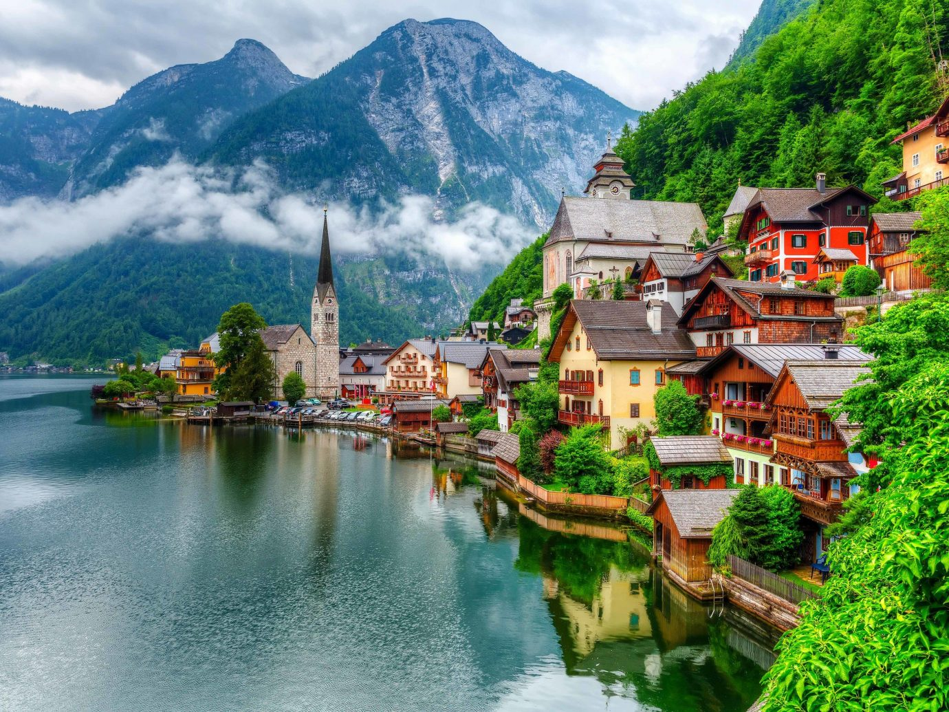 Lakes + Rivers Outdoors + Adventure mountain outdoor tree water mountain village Nature mount scenery mountainous landforms mountain range reflection Lake tourist attraction sky hill station tourism alps River Village fjord watercourse bank landscape resort town leisure national park computer wallpaper reservoir City surrounded