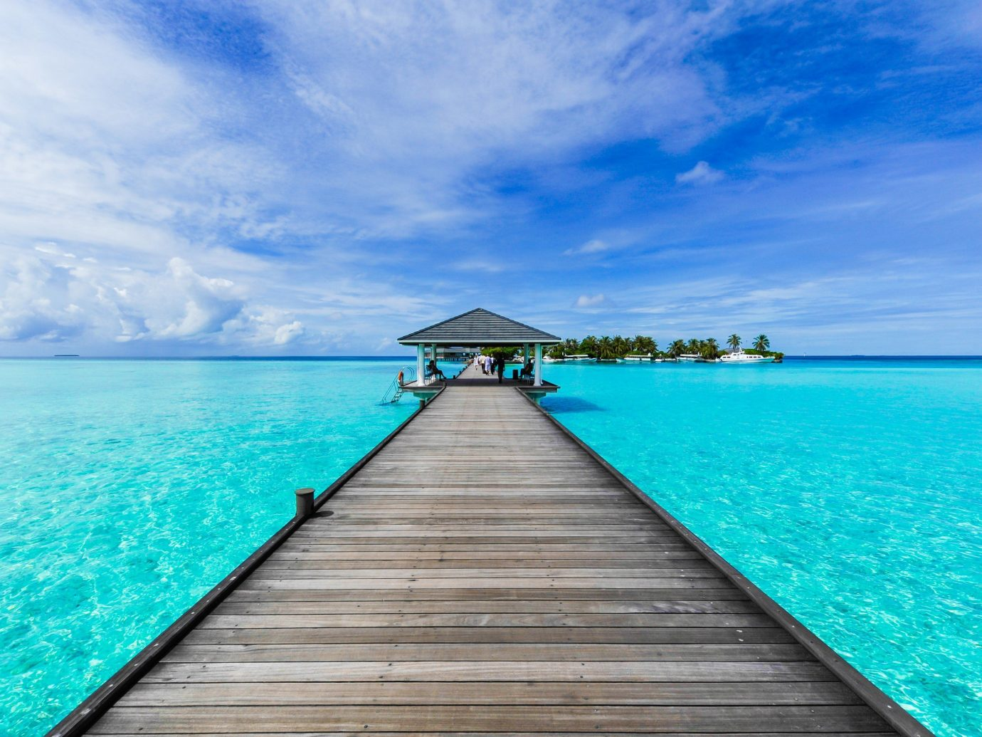 Offbeat water sky pier scene outdoor Boat wooden Sea blue horizon Ocean caribbean vacation shore Coast Beach bay Island dock Lagoon wood