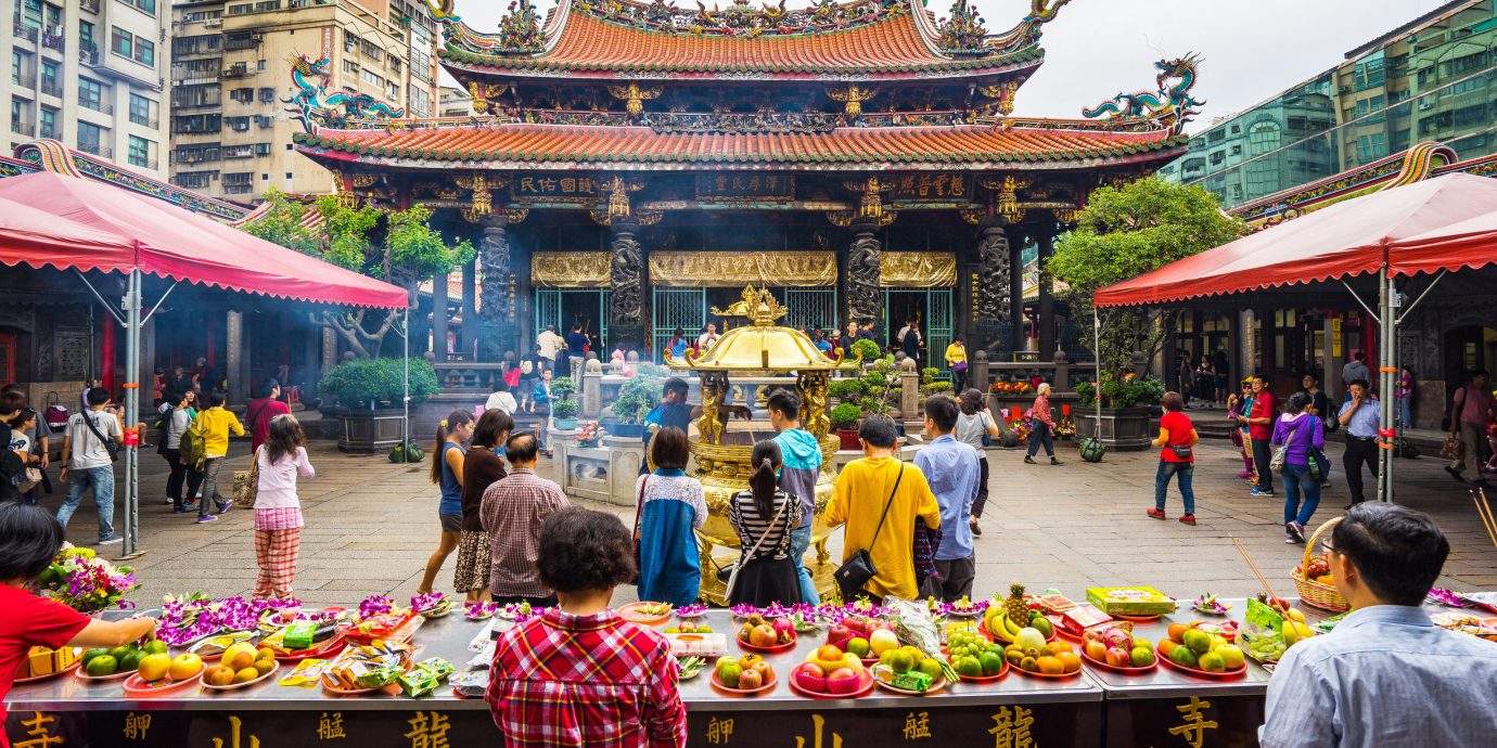 Arts + Culture Taipei Travel Tips Trip Ideas public space chinese architecture marketplace City market leisure shrine temple tourism crowd bazaar street fair