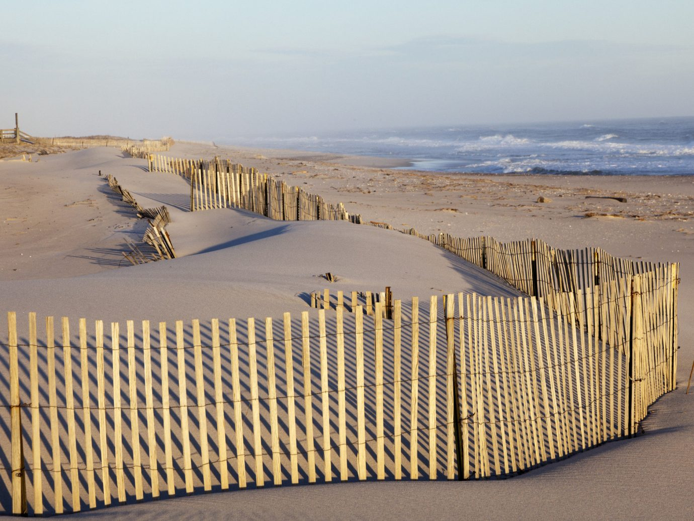 Trip Ideas sky outdoor habitat sand Beach natural environment shore Coast Sea dune aeolian landform Ocean wood landscape terrain material Desert sandy