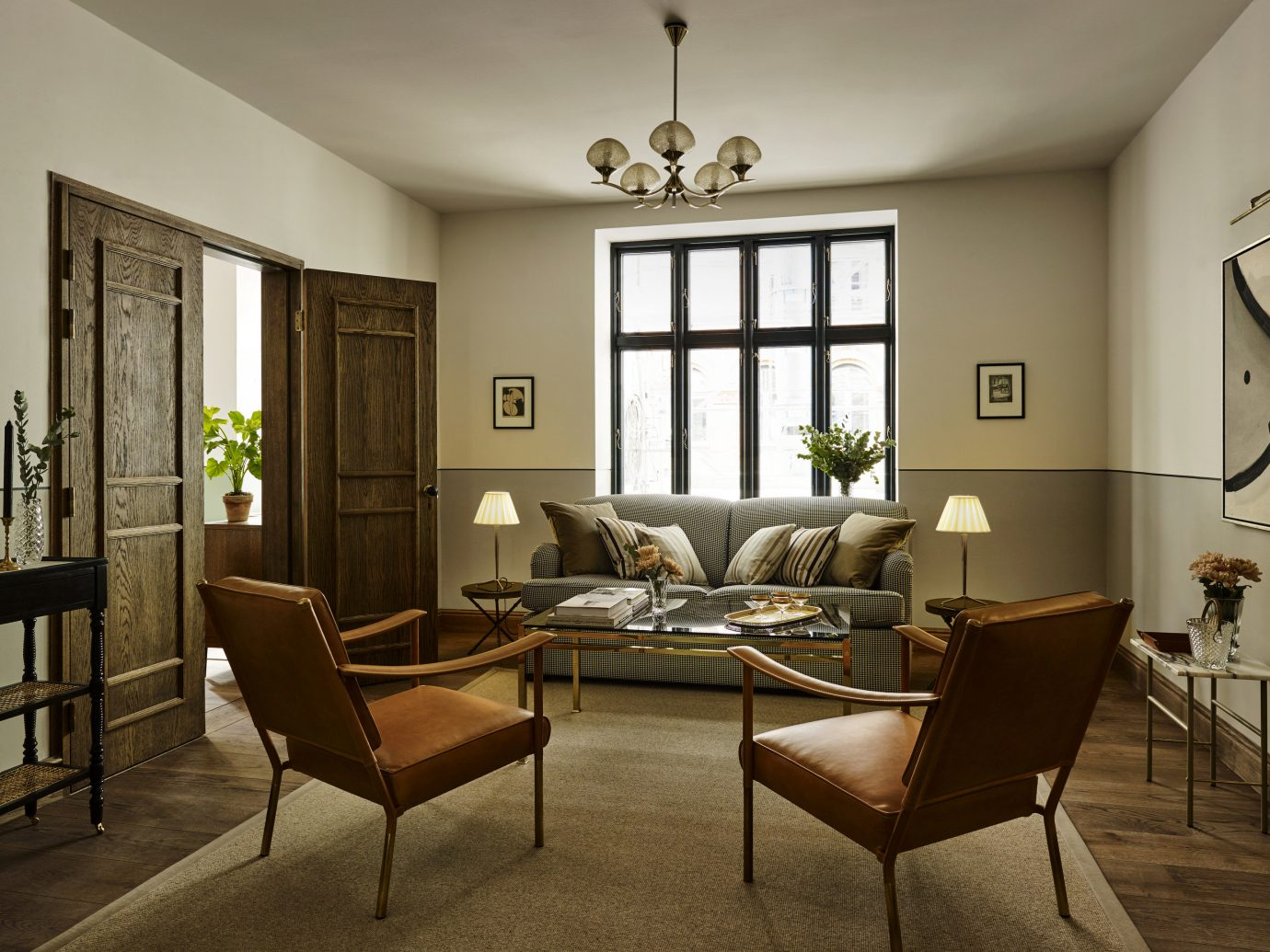 Copenhagen Denmark Design Hotels Trip Ideas indoor floor wall ceiling table room living room chair Living interior design dining room furniture window real estate home flooring interior designer hotel house area several
