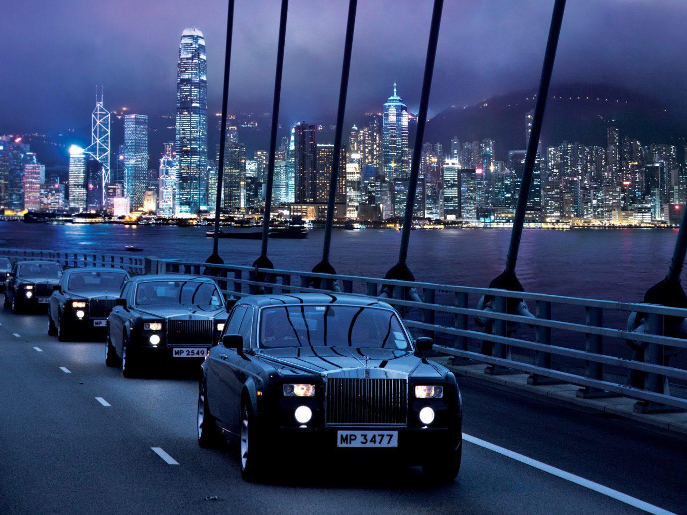 Offbeat sky outdoor road car vehicle land vehicle luxury vehicle City night cityscape highway