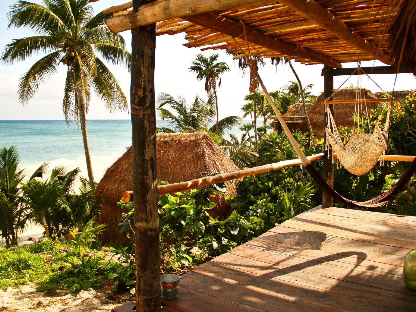 Beachfront Deck Eco Hotels Island Villa tree outdoor sky Resort vacation palm arecales tropics estate Jungle palm family plant shade
