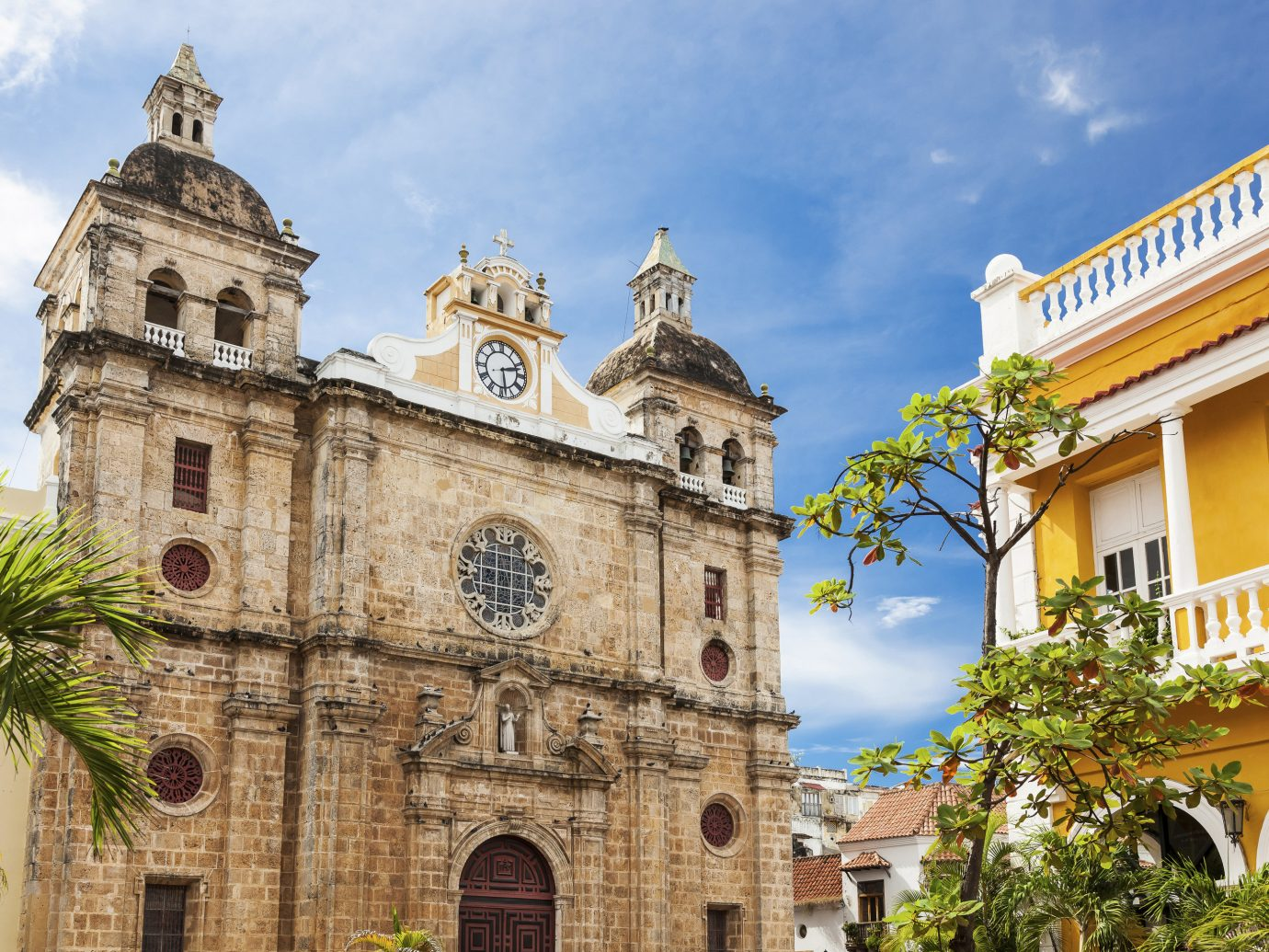 Travel Tips Trip Ideas building outdoor historic site Town landmark place of worship yellow tourism facade Church cathedral estate synagogue monastery basilica tall old stone tan