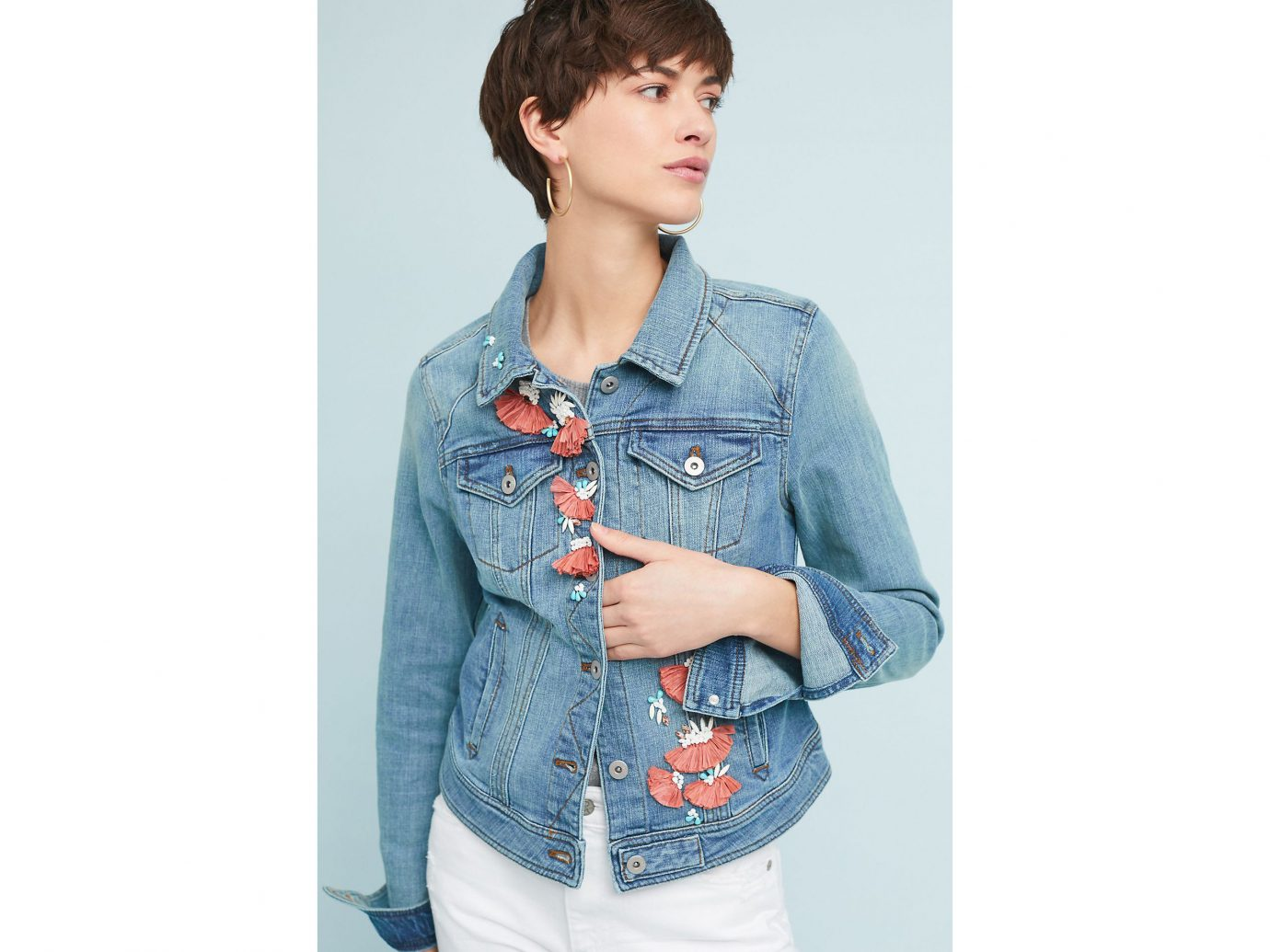 Packing Tips Spring Travel Style + Design Travel Shop person clothing denim standing jeans sleeve shoulder outerwear textile fashion model posing shirt button jacket blouse hand