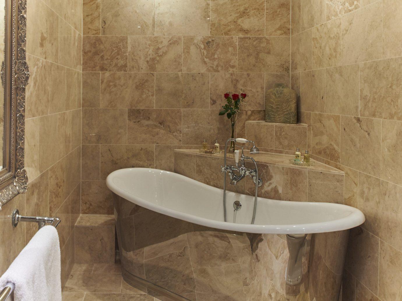 Trip Ideas wall indoor bathroom room bathtub toilet plumbing fixture floor vessel tub tile flooring sink interior design bidet Bath water basin tiled stone dirty